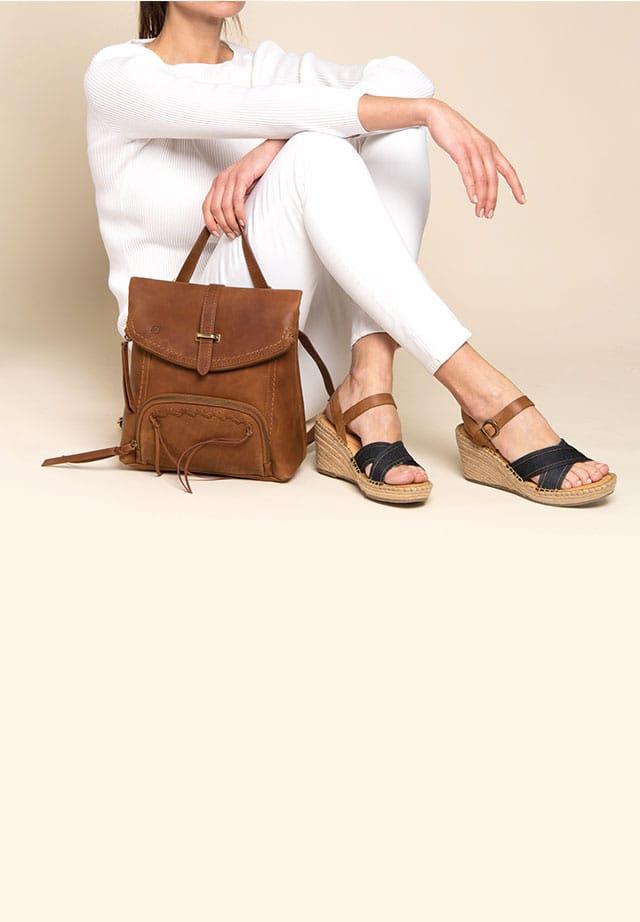 Woman wearing Børn sandals with Børn handbag